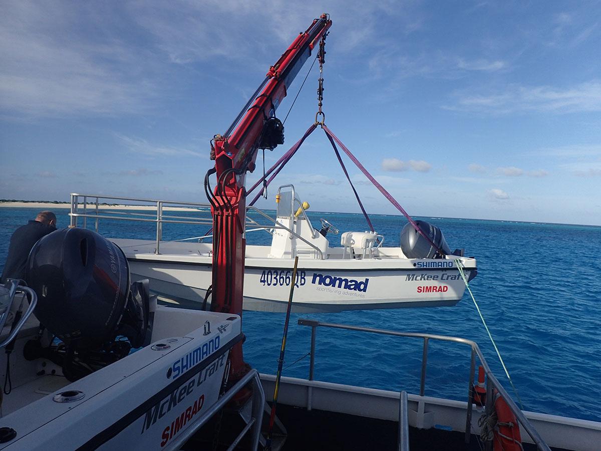 Crew lowering boat