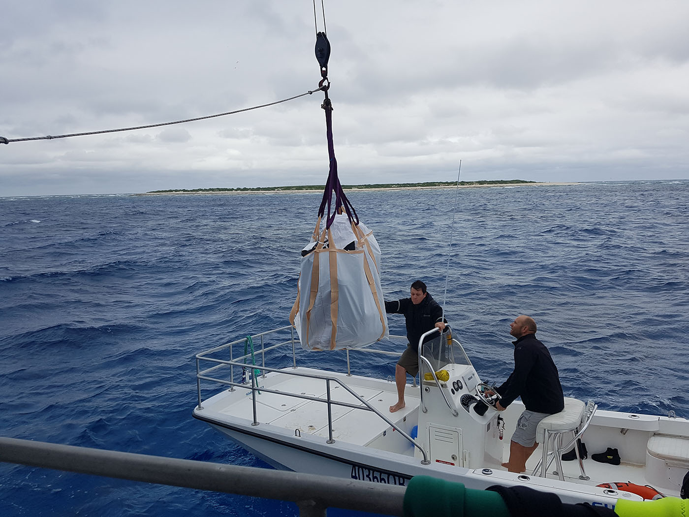 Transferring equipment from the tender to the Odyssey