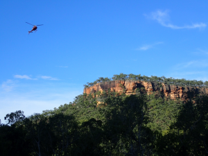Red cliffs, blue skies, and the wing-beat of our day-end transport (image credit S. Nally)