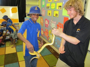 Stephen Mahoney, Australian Museum, shows off his snake wrangling techniques.