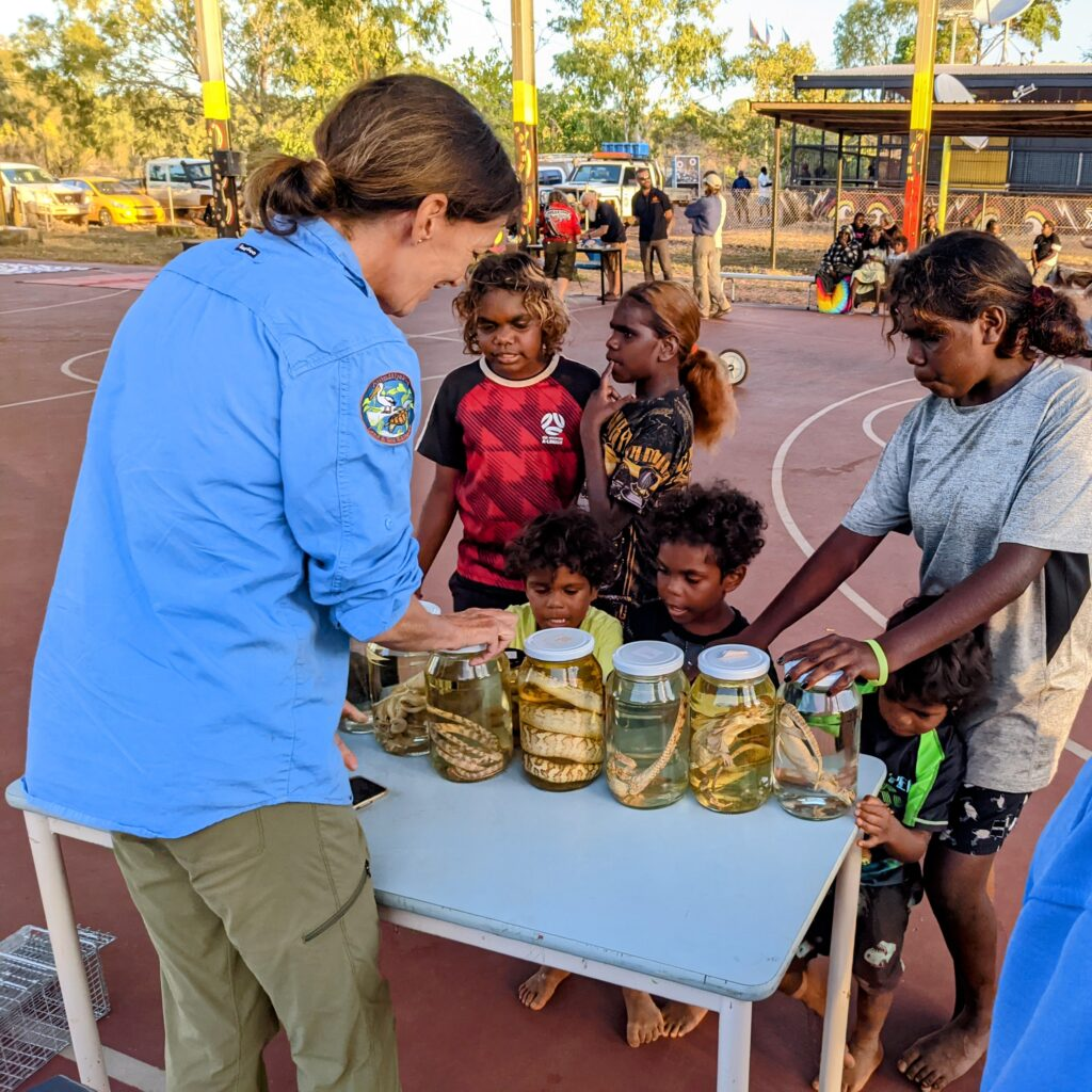 A land manager and scientists engaging with an Indigenous community
