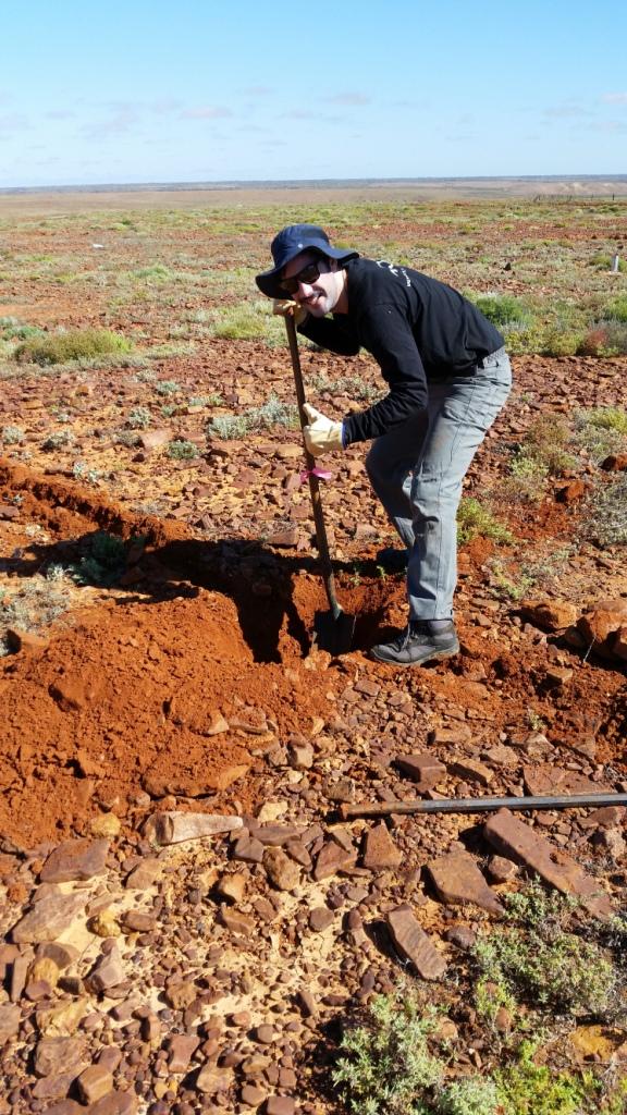 John digging a pitfall trapline