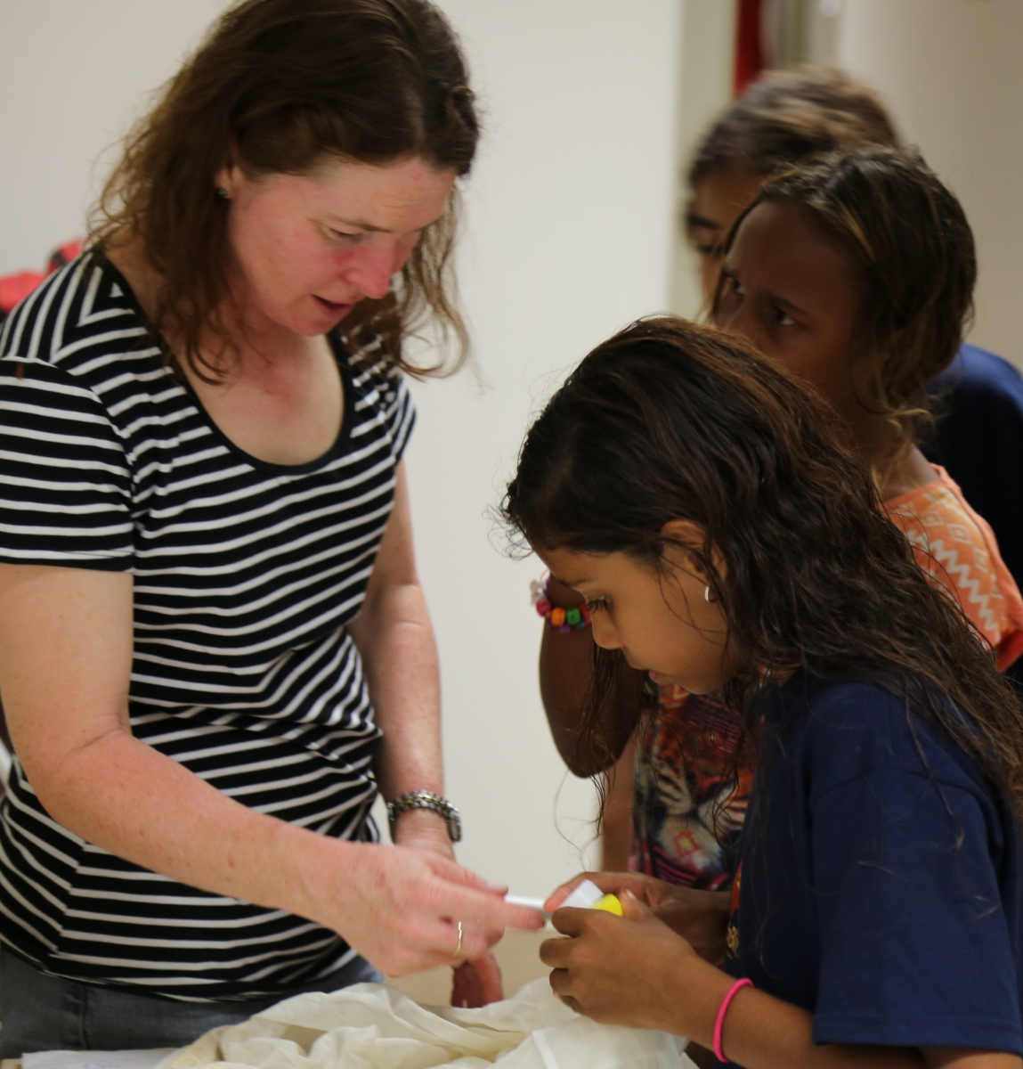 Laura children select vials before collecting invertebrates at Quinkan community day (image credit S. Nally)
