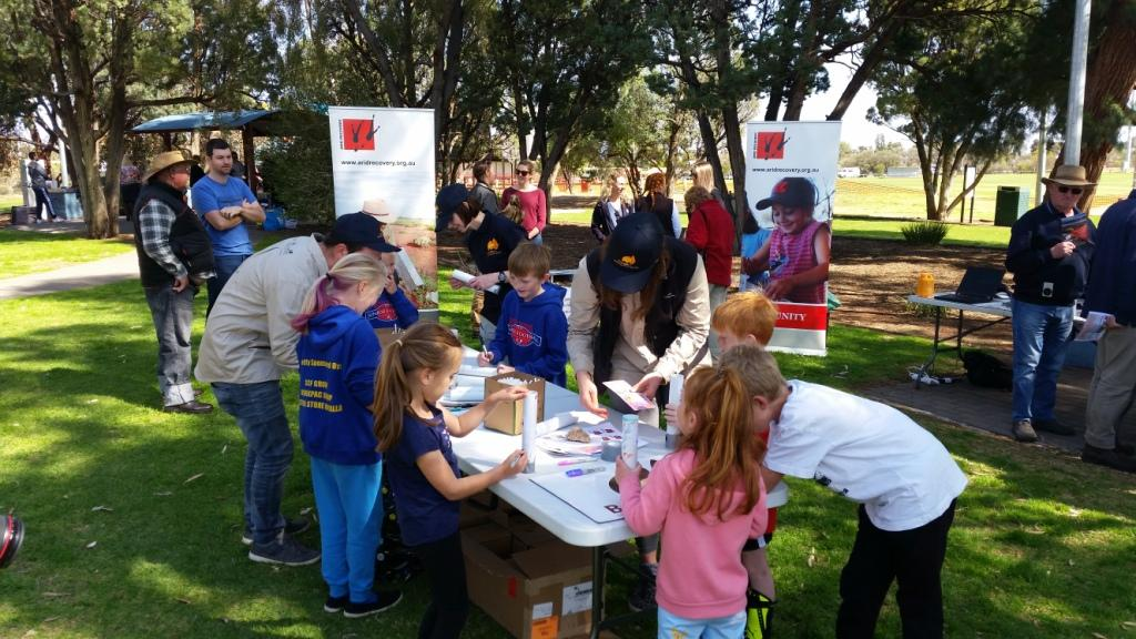 Matt and Ingrid showing kids how to make bee hotels